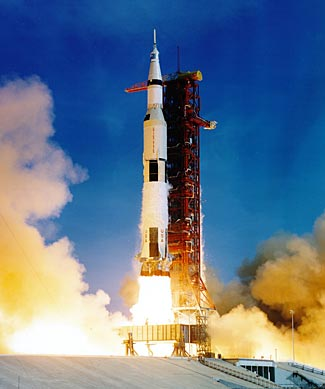 Apollo 11 lifts off, powered by five mighty F-1 rocket motors developing 7.6 million lbs of thrust and consuming 15 tons of fuel every second.  What's that in mpg?