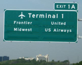 The story of US airlines as told by freeway signs.  Frontier - up for sale.  Midwest - closed in 2011.  United - merged with Continental.  US Airways - hoping to merge with American.