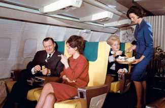 No matter how much this Lufthansa staged publicity shot tried to pretend otherwise, the 707s changed first class to just plain rows of seats all facing forward. No more lounges, sofas, beds.