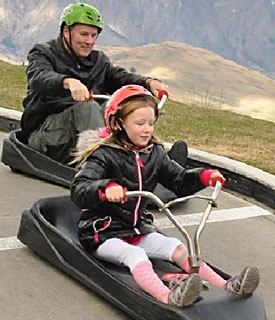 Your tour leader and his daughter, five years back, racing down a luge in New Zealand.