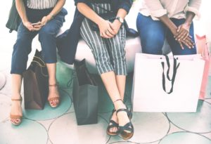 Women sitting together with shopping bags.