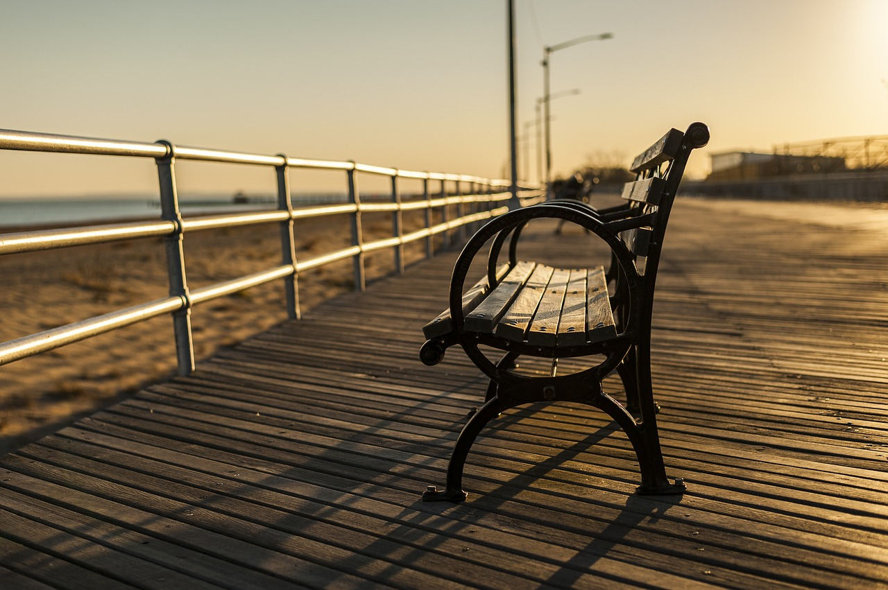 A bench on a boardwalk.
