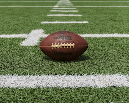 A football sitting in the middle of a field.