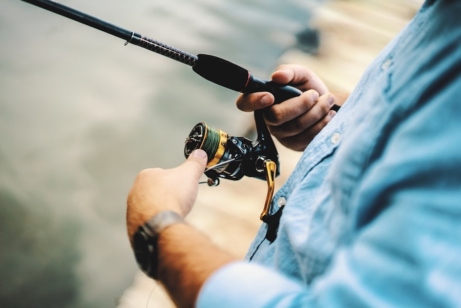 A person fishing as part of their New Year's resolutions.