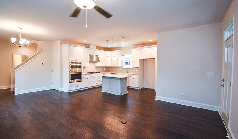 open floor plan with living room leading into kitchen
