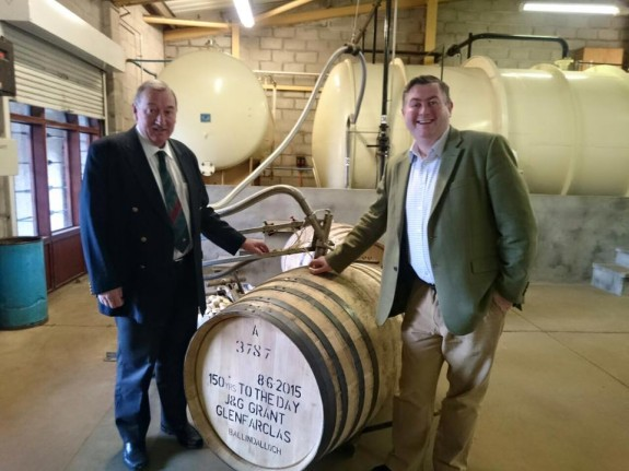 John LS and George S Grant filling their casks