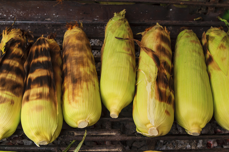 stock image of corn grilling on a BBQ
