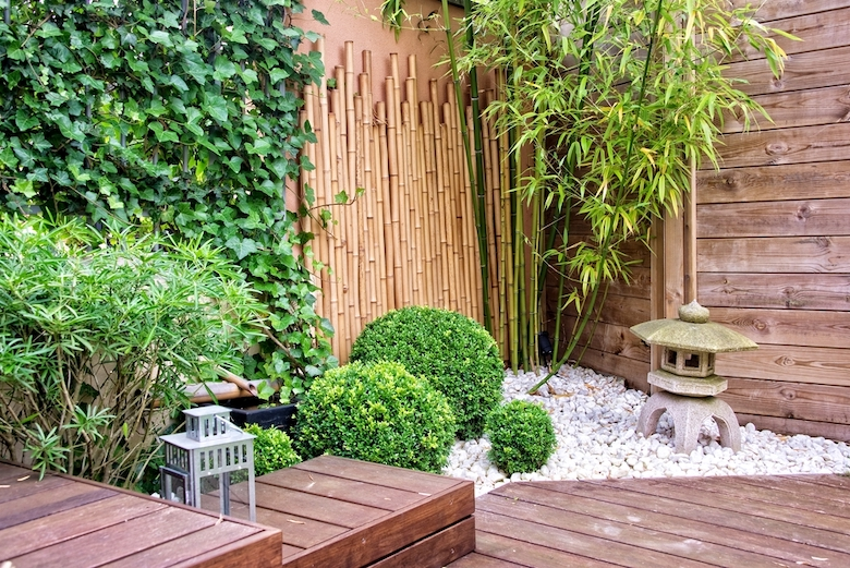 Bamboo used as fencing with green shrubs