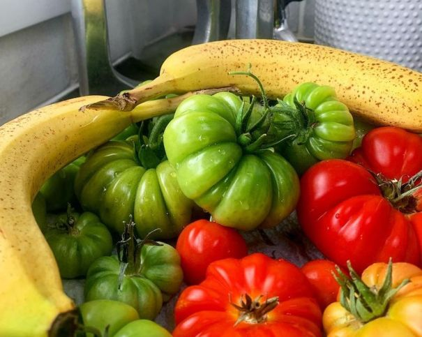 Tomatoes in a bowl with bananas