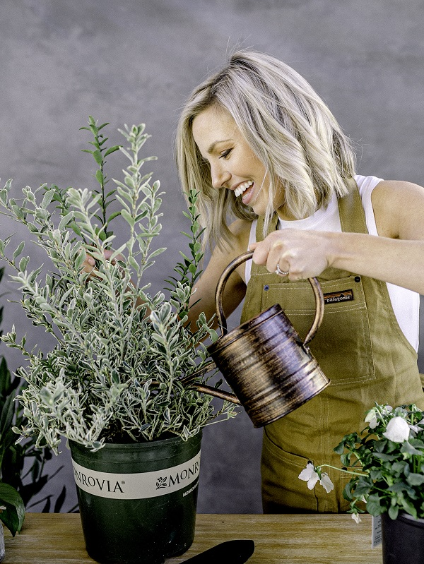 Those Plant Ladies: Fawn watering potted shrub with a watering can