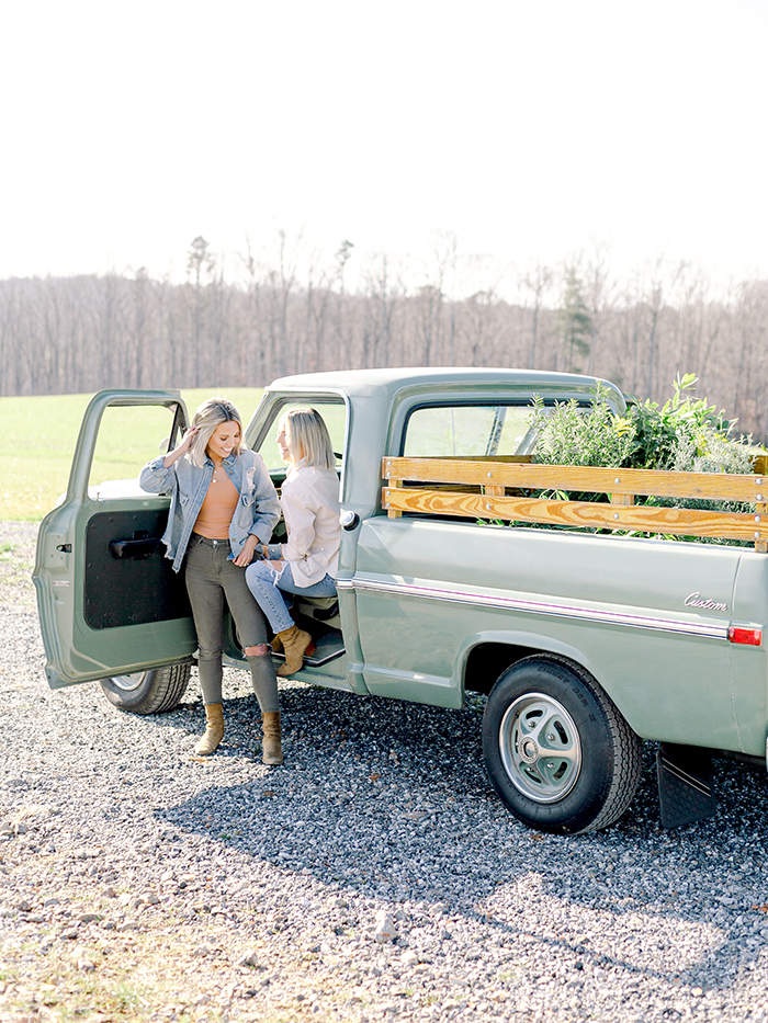 Fawn and Heather of Those Plant Ladies with an antique Ford truck at their brand story photo and video shoot.
