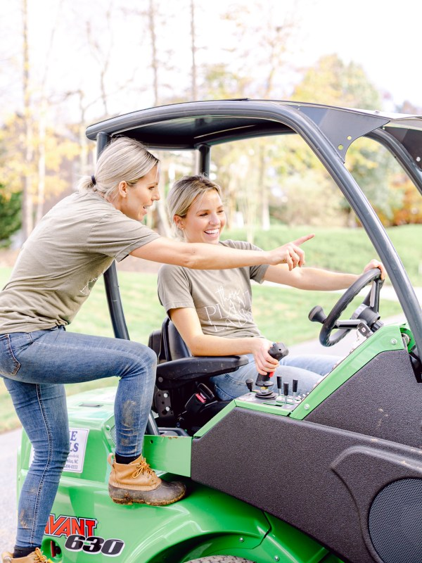 Fawn and Heather, CEOs of Those Plant Ladies, using the Avant Loader 630.