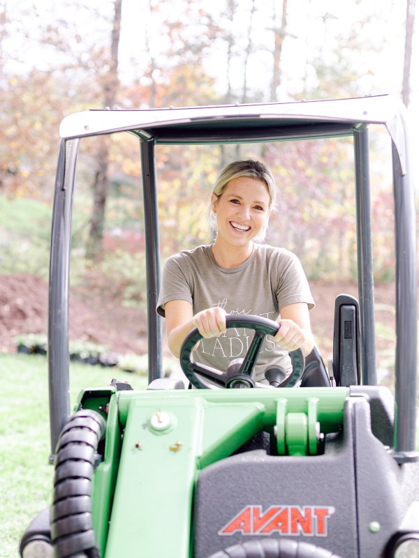 Fawn, CEO of Those Plant Ladies, driving the Avant Loader 630.