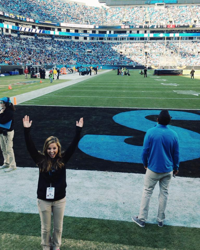 Fawn of Those Plant Ladies signaling a touch down on game day at Bank of America Stadium.