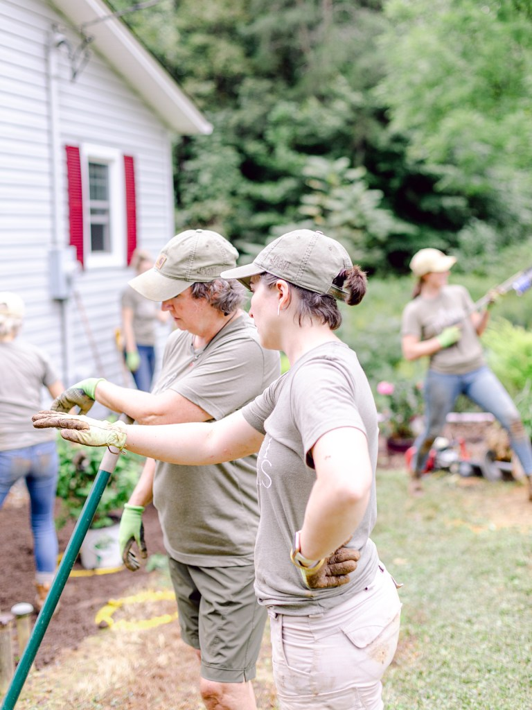 Alexa of Those Plant Ladies instructing the crew at a landscape installation in North Carolina.