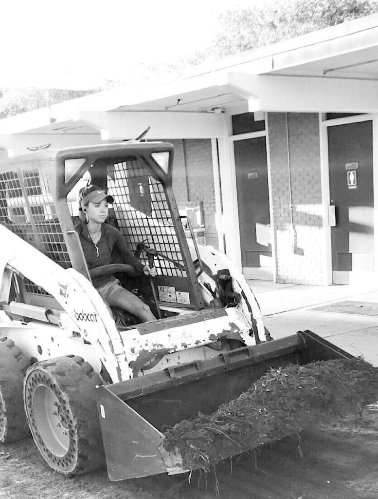 Fawn Wilson driving a bobcat.