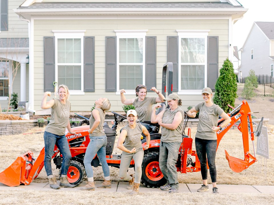 The crew from Those Plant Ladies making the muscle post in front of the sponsored Kubota tractor; in Charlotte, NC.