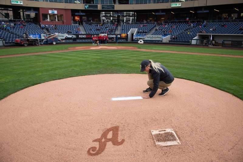 Leah Withrow of the Reno Aces prepping the mound; featured on the Industry Spotlight series with Those Plant Ladies.