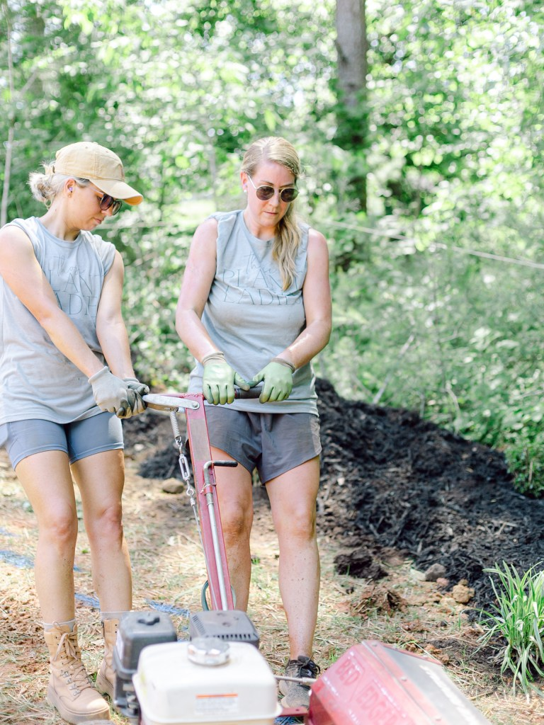 The crew of Those Plant Ladies using the bededger at The Blooming Estate landscape installation.