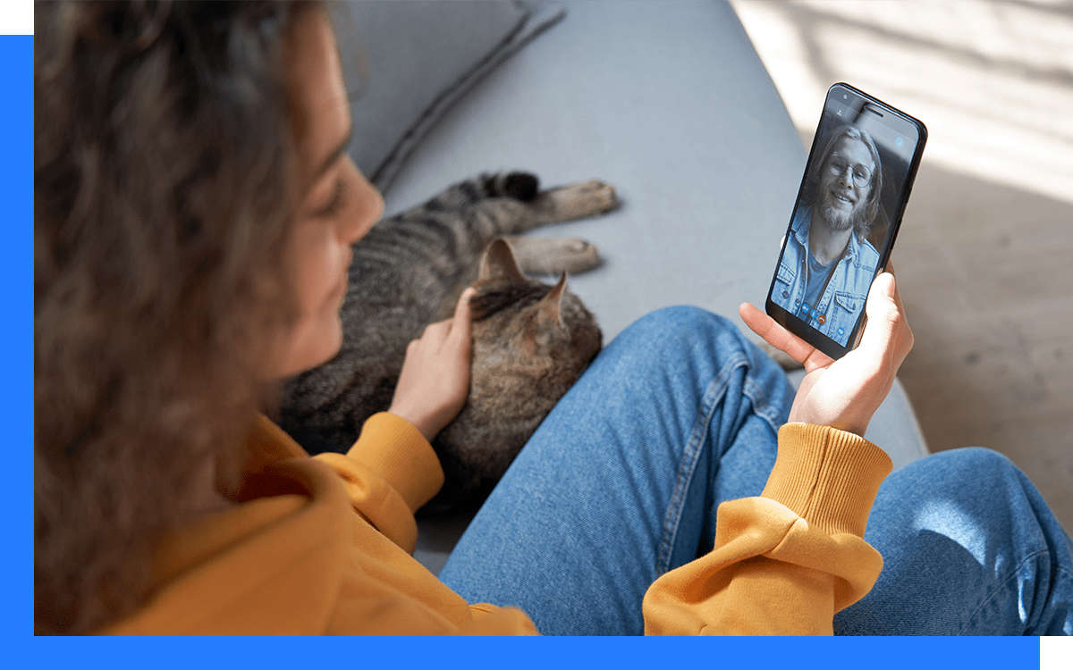 Women connecting with colleagues through video call.