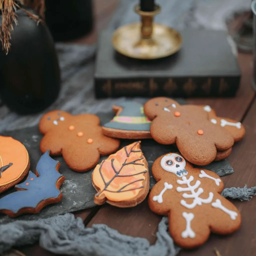 Ginger Halloween cookies decorated as skeletons, bats and vampires