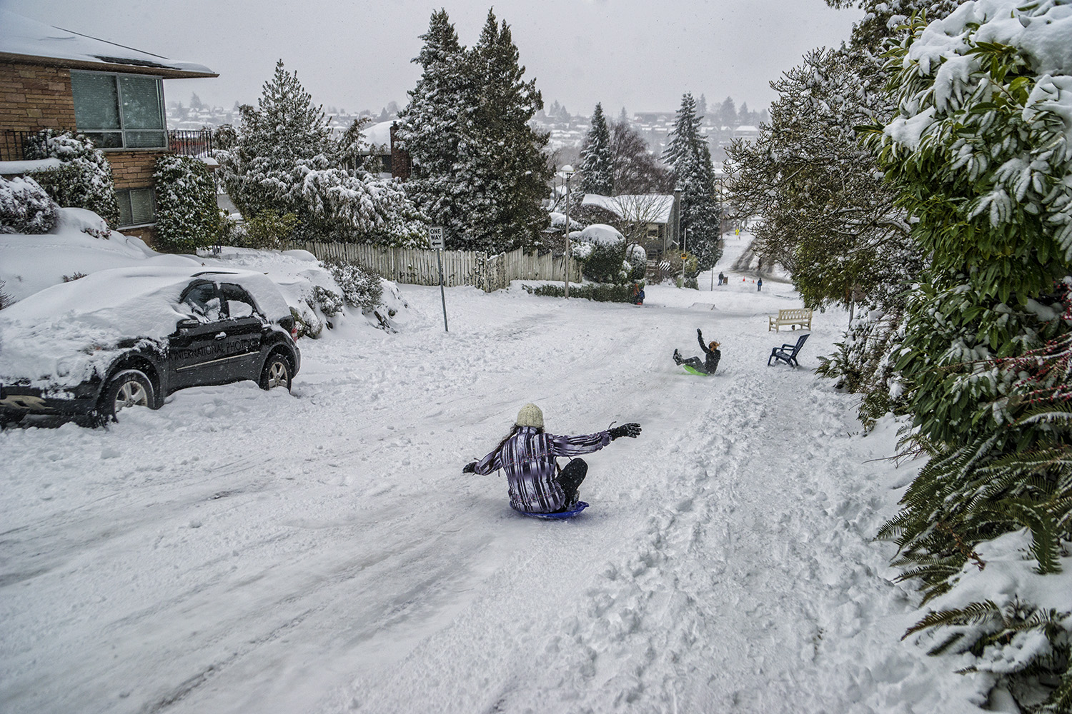 Sledding down McGraw Street, Magnolia, Seattle (February 13, 2021).