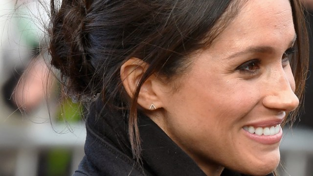 CARDIFF, UNITED KINGDOM - JANUARY 18: Meghan Markle smiles during a visit Cardiff Castle with Prince Harry on January 18, 2018 in Cardiff, Wales. (Photo by Anwar Hussein/WireImage)