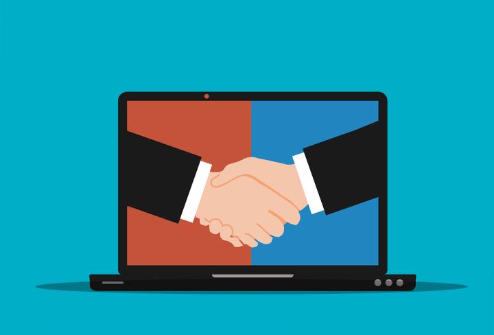 animated handshake on the laptop screen