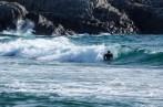 Surfer på Sandvesand