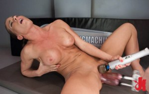 Muscular woman gets fucked in her cunt and ass hole while rubbing her clit with a toy
