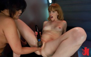 Brunette woman fists her ginger friendÆs pussy while she rubs her clit with a Hitachi toy