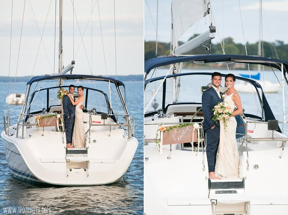 Bride and Groom Sailing away from their wedding •  tPoz Photography •  www.tpozphoto.com