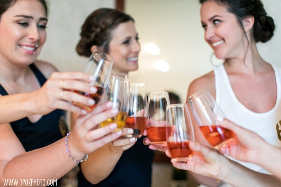 Bridesmaids popping champagne bottles •  tPoz Photography  •  www.tpozphoto.com