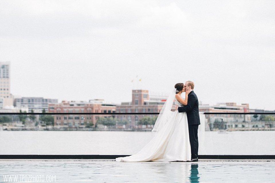 Sagamore Pendry Pool wedding photos bride & groom kissing • tPoz Photography • www.tpozphoto.com