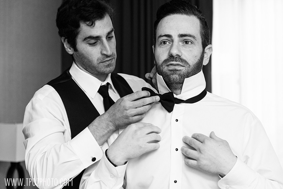 Greek Groom getting dressed for his wedding • tPoz Photography  • www.tpozphoto.com