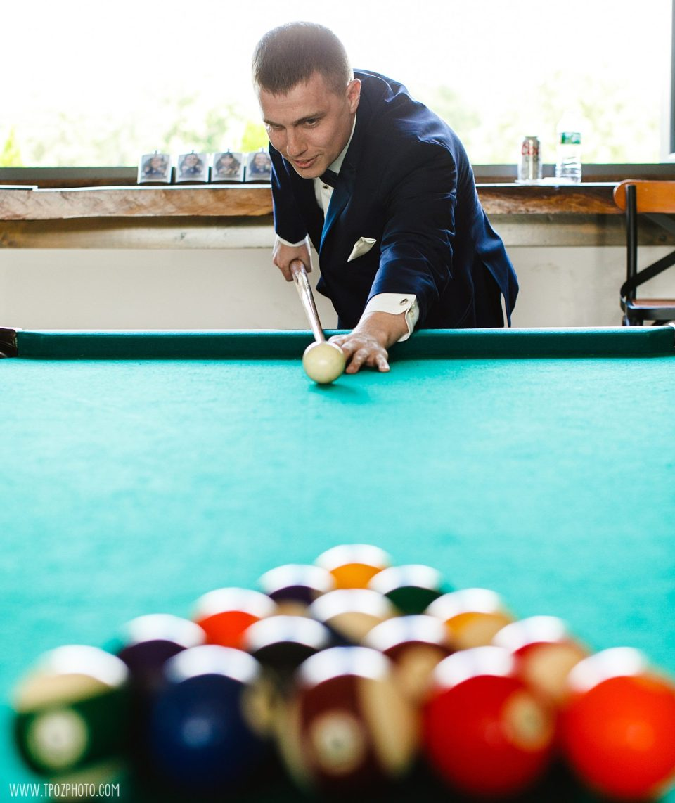 Groom plays Pool in the Groom's Lounge at Rosewood Farms