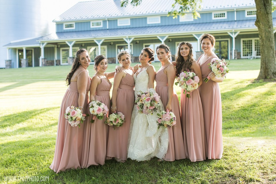 Bridesmaids in pink dresses at Rosewood Farms