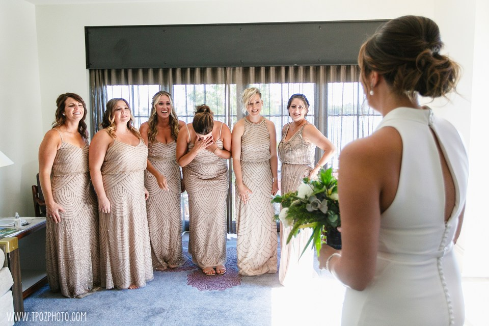 bridesmaids react to bride in wedding dress on at Sagamore Pendry Hotel