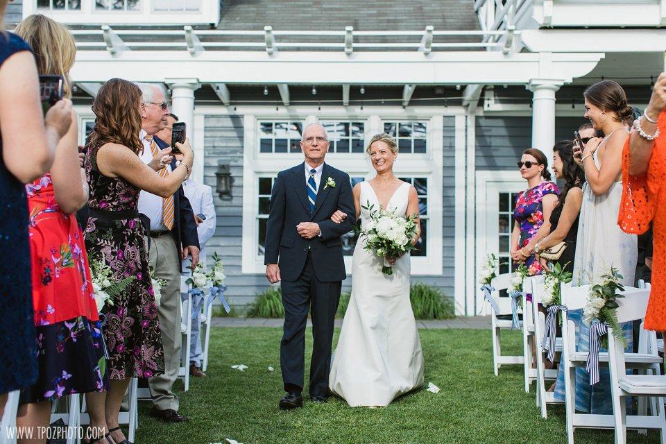 Bride walks down the aisle at the Chesapeake Bay Beach Club