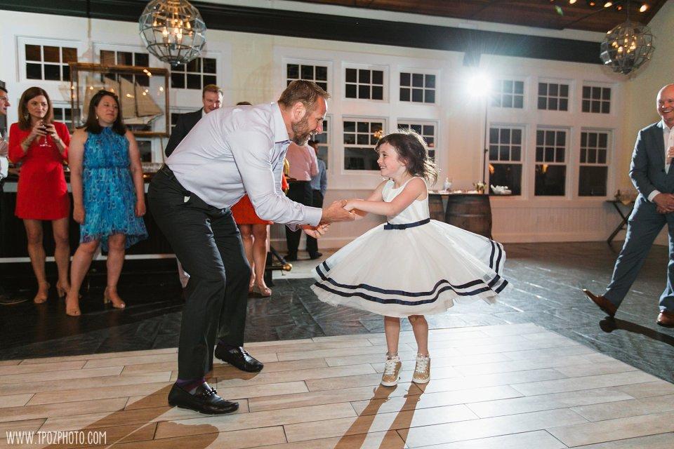 flower girl dancing at a wedding