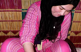 Berber woman making Argan Oil at an Argan Cooperative