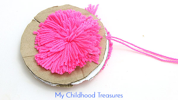 how-to-make-cardboard-pom-poms-6