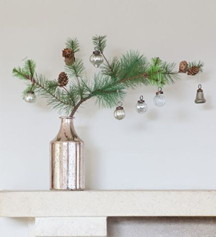 24-a-pine-branch-with-pinecones-and-some-vintage-ornaments-in-a-single-stem-vase
