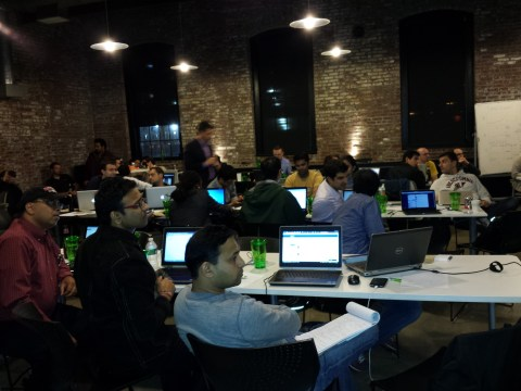 Our team hard at work, in the middle of the room