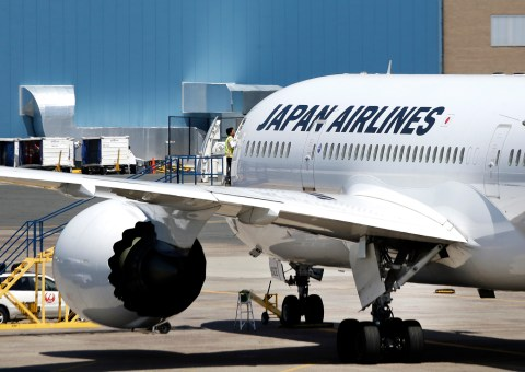 An airport worker enters a Japan Airlines Boeing 787 aircraft as it sits on the tarmac at Terminal E at Logan International Airport in Boston Friday, July 19, 2013. The JAL aircraft's flight to Tokyo returned to Boston on Thursday because of a possible fuel pump issue. It's the latest trouble for the new Dreamliner aircraft after a lithium ion battery problem grounded the fleet in January. (AP Photo/Elise Amendola)