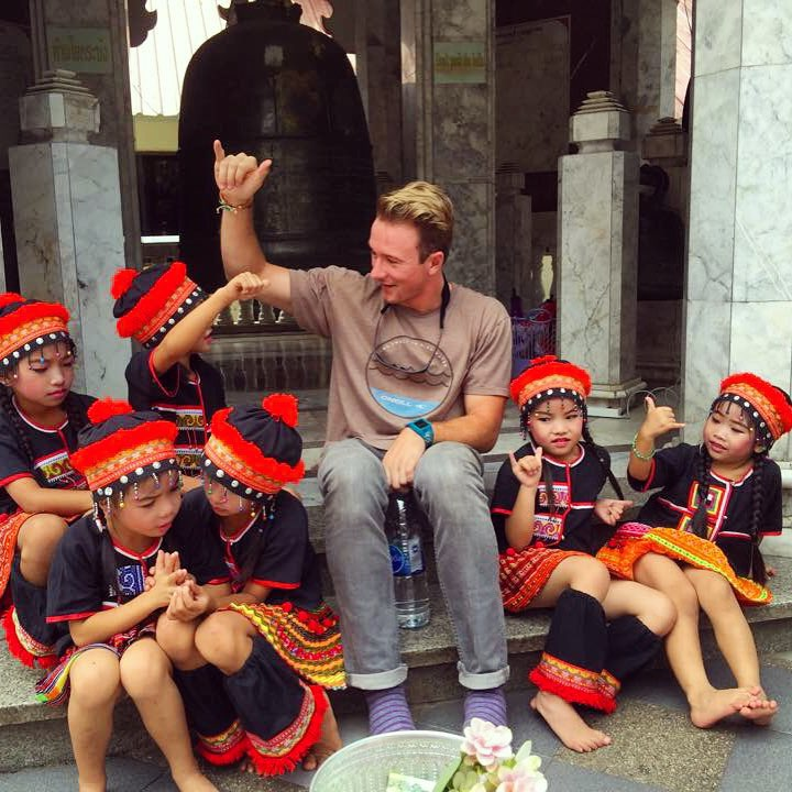 Tourist Posing For a Photo With Local Children in Chiang Mai