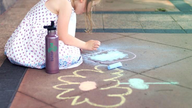blackboard chalk drawing on the sidewalk, power online tutoring jobs - tutor.id