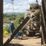 Filling wheelbarrow from truck