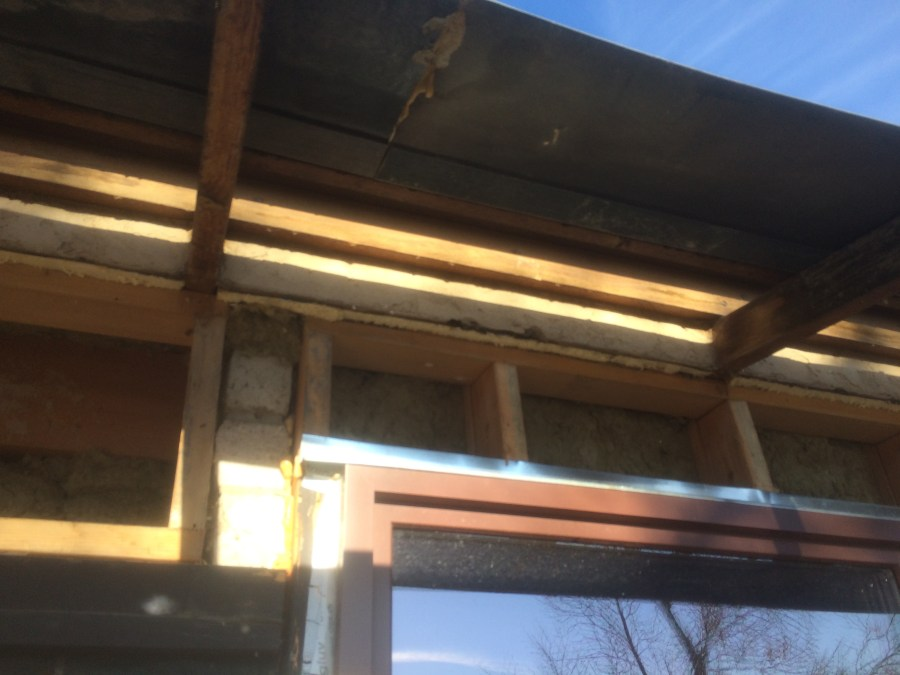 Insulation Going In Above Window