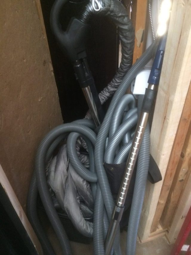 Closet full of vacuum attachments